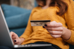 Lady with credit card buying online