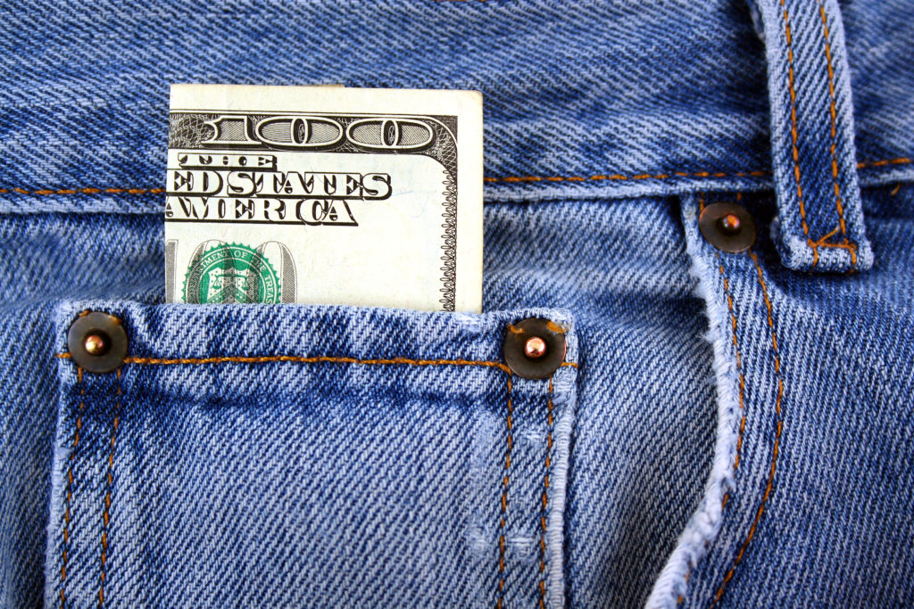 A One hundred dollar bill in jeans pocket